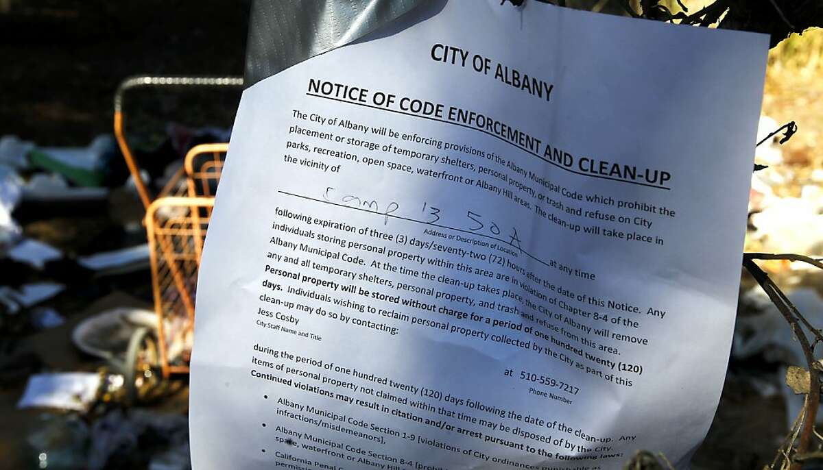 A clean up notice posted at one of the encampments on the Bulb on Friday Nov. 22, 2013 in Albany, Ca. The City of Albany is implementing a waterfront park transition plan that would move people living in the Albany Bulb into a temporary shelter, with the eventual transfer of the Bulb to McLaughlin Eastshore Park.
