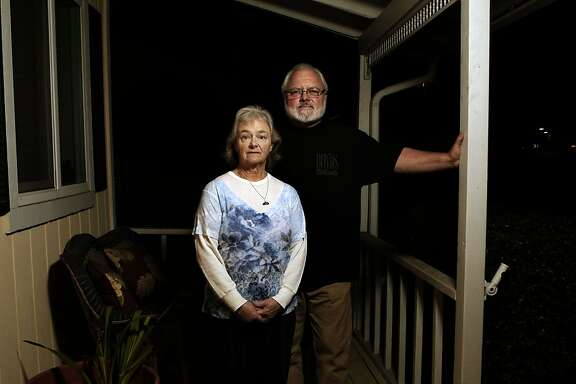 Sandy and Jim Hague on the front porch of their home in Pleasanton, Ca., on Thursday Nov. 7, 2013. Jim and Sandy Hague are still waiting for the death certificate and the cause of death for their 35 year old son Joshua who died in San Francisco in January of 2013.