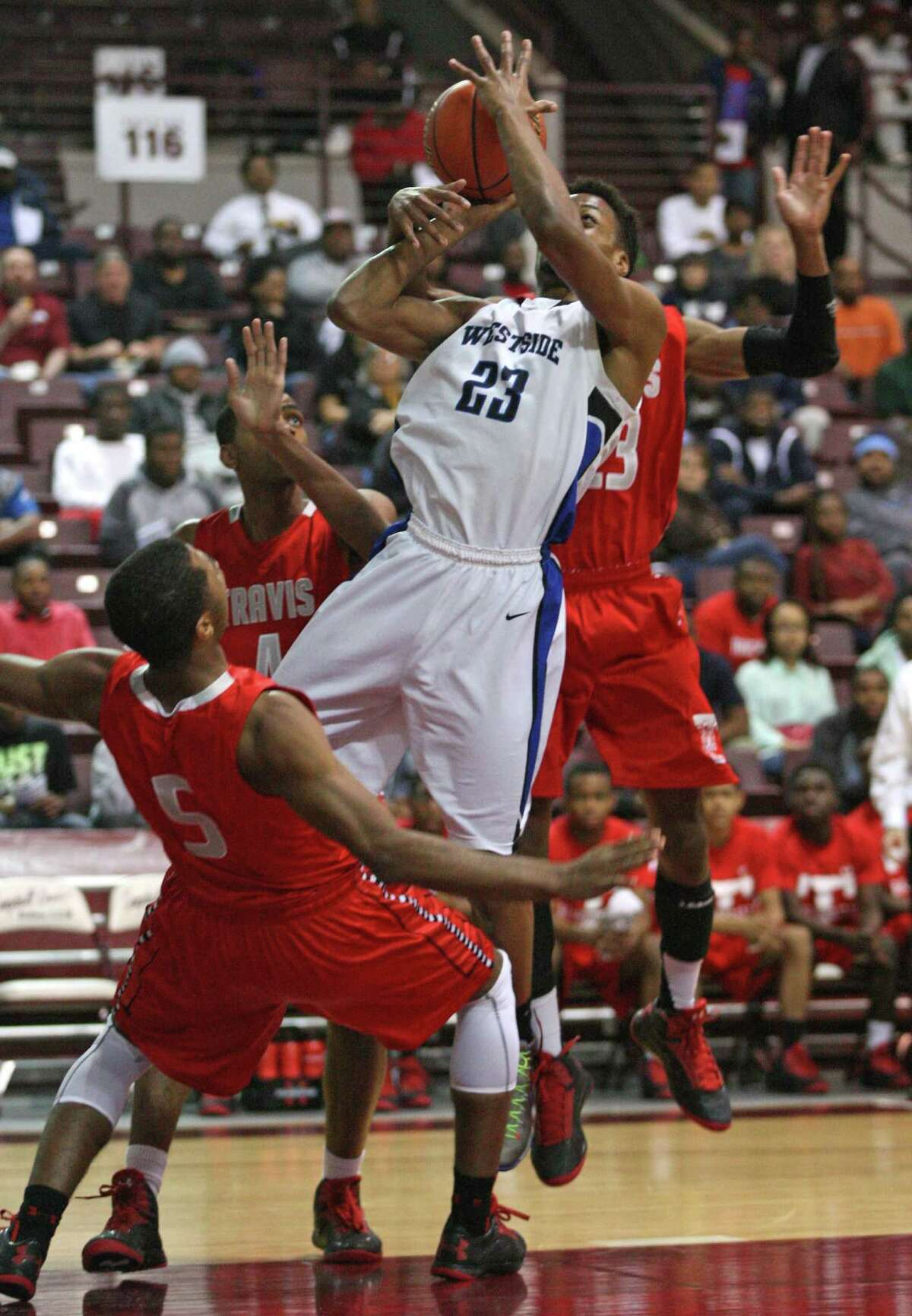 Westside's Franklin Iheanacho (23) shoots over Fort Bend Travis' Andrew Harrison (5) during the first half of a 5A Region III high school playoff basketball game, Friday, March 1, 2013 at the Campbell Center in Houston, TX. (Photo: Eric Christian Smith/For the Houston Chronicle)