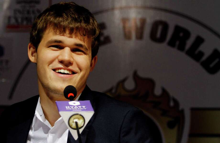 Magnus Carlsen was all smiles Friday after taking the title from Viswanathan Anand in Chennai, India. Photo: Arun Sankar K., STR / AP