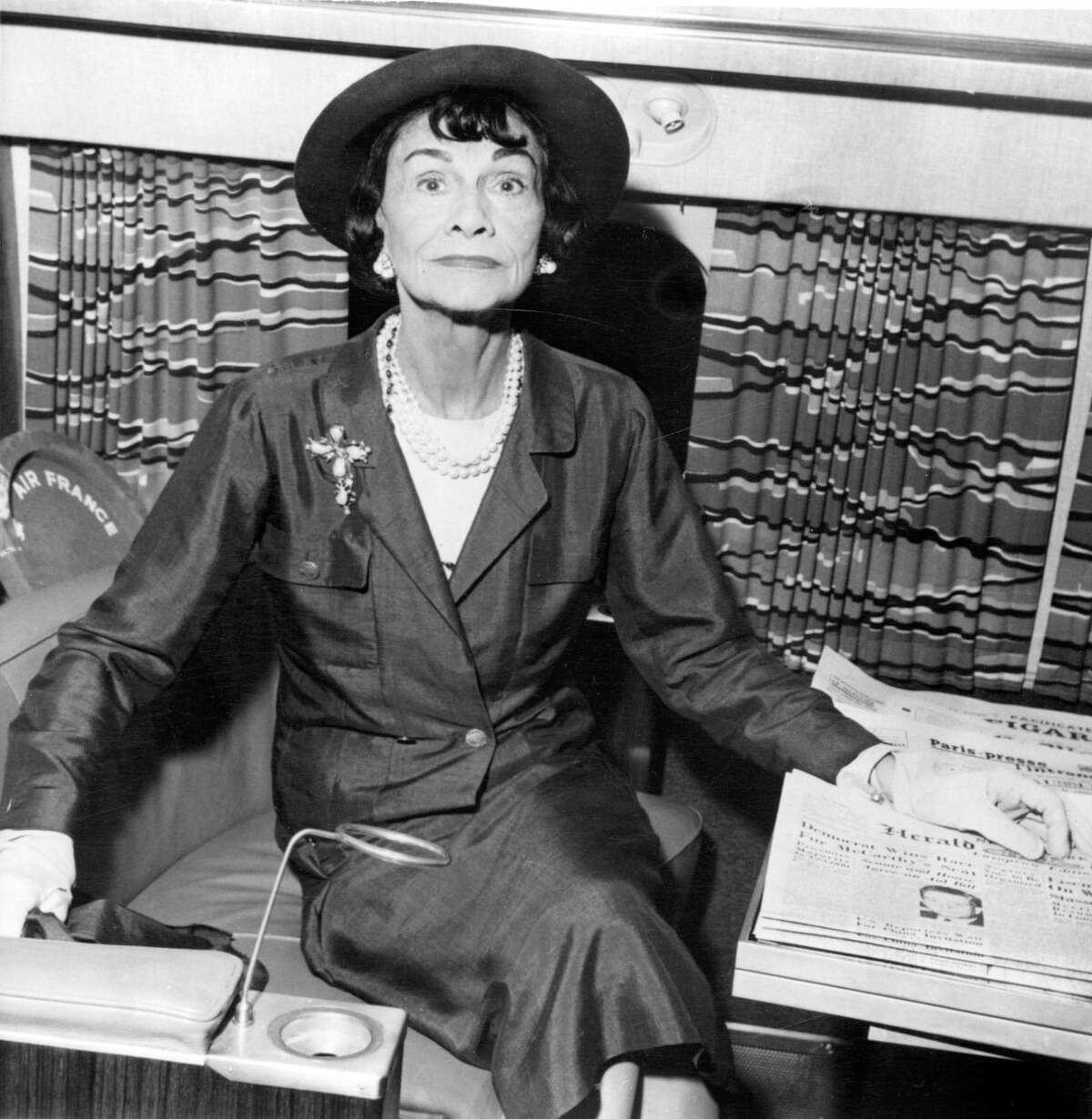 """This undated photo shows French fashion designer Gabrielle """"Coco"""" Chanel, a fashion icon whose name has become shorthand for timeless French chic, at an undisclosed location. A new book published in the U.S on Tuesday, Aug. 16, 2011, by Knopf, suggests Chanel not only had a wartime affair with a German aristocrat and spy, but that she herself was also an agent of Germany's Abwehr military intelligence organization and a rabid anti-Semite. (AP Photo)"""