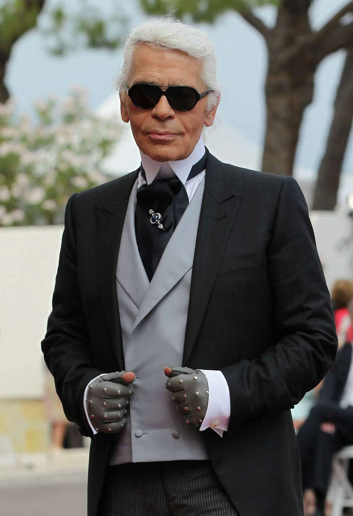 MONACO - JULY 02: Karl Lagerfeld attends the religious ceremony of the Royal Wedding of Prince Albert II of Monaco to Princess Charlene of Monaco in the main courtyard at the Prince's Palace on July 2, 2011 in Monaco. The Roman-Catholic ceremony follows the civil wedding which was held in the Throne Room of the Prince's Palace of Monaco on July 1. With her marriage to the head of state of the Principality of Monaco, Charlene Wittstock has become Princess consort of Monaco and gains the title, Princess Charlene of Monaco. Celebrations including concerts and firework displays are being held across several days, attended by a guest list of global celebrities and heads of state. (Photo by Sean Gallup/Getty Images)