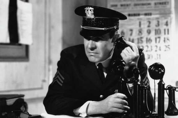 The Hale family's first phone was a candlestick model similar to this one used by an American police officer, circa 1935.
