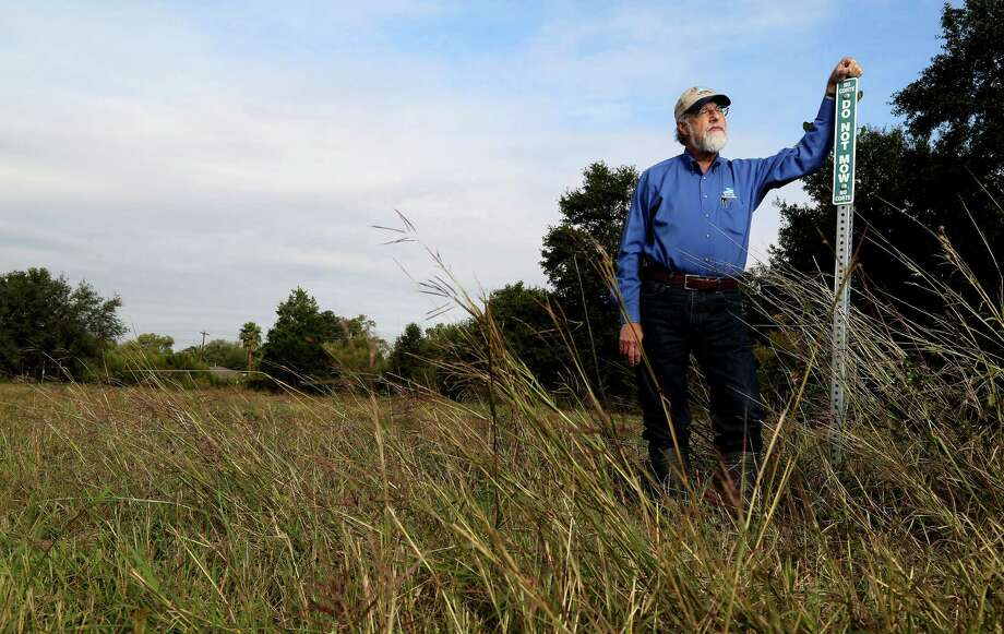 Glenn Laird of the flood-control district's environmental services division is working to save Willow Waterhole's prairie. Photo: Karen Warren, Staff / © 2013 Houston Chronicle