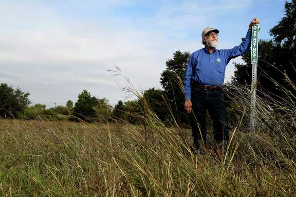 Glenn Laird of the flood-control district's environmental services division is working to save Willow Waterhole's prairie.