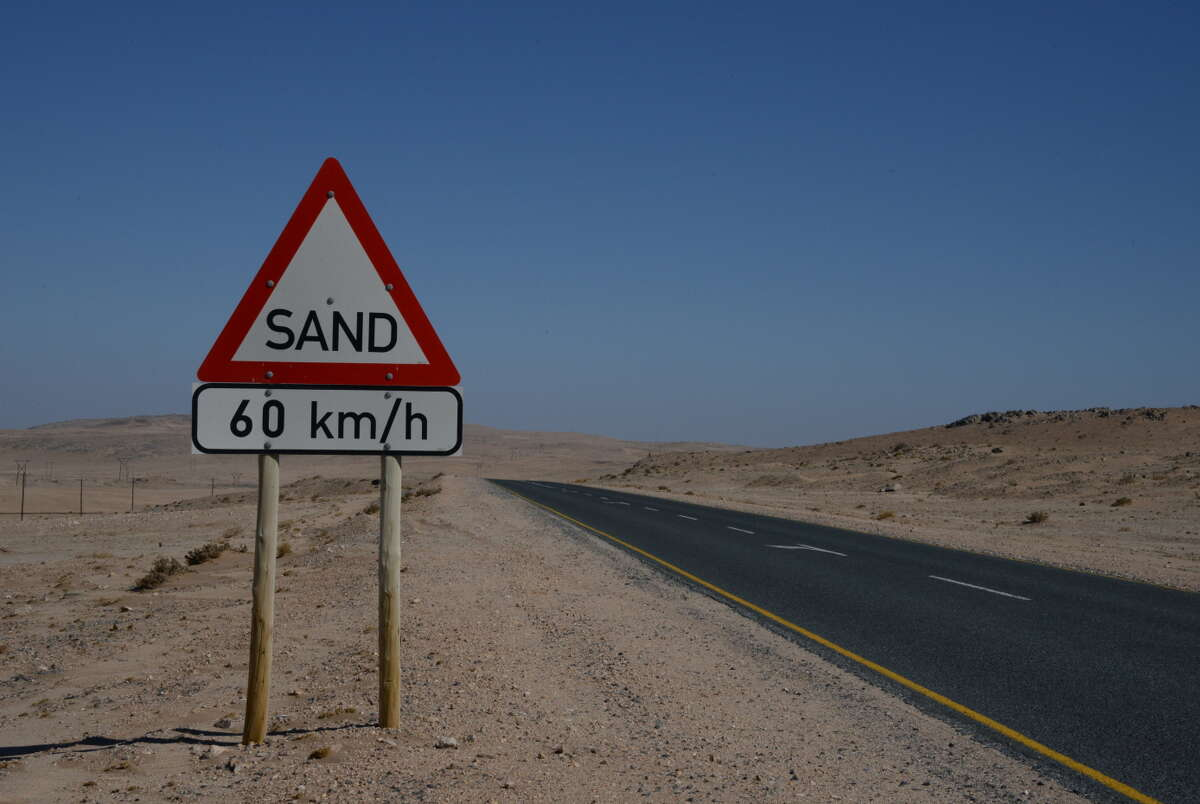 Signs line the road near the Namib Desert to warn of windborne sand.