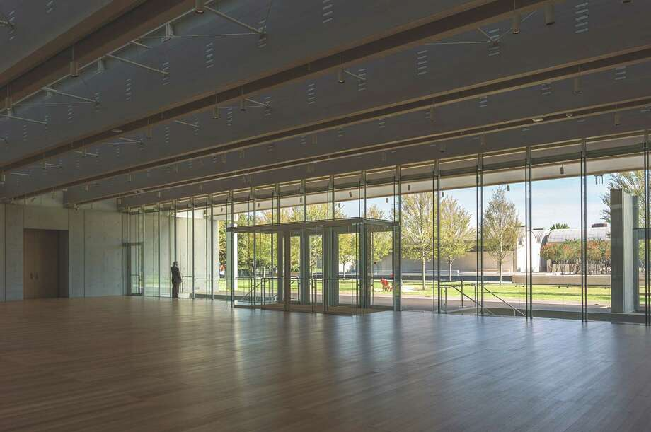 The lobby of the Kimbell Art Museum's new Renzo Piano Pavilion offers views across a lawn to the institution's landmark Louis Khan building. Photo: Robert Polidori / ONLINE_YES