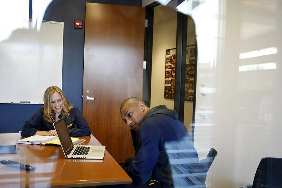 Football player Khairi Fortt attends an academic progress meeting with adviser Johnna Strenchockon. Cal is increasing the number of full-time learning specialists as part of an academic improvement plan. Photo: Michael Short, The Chronicle