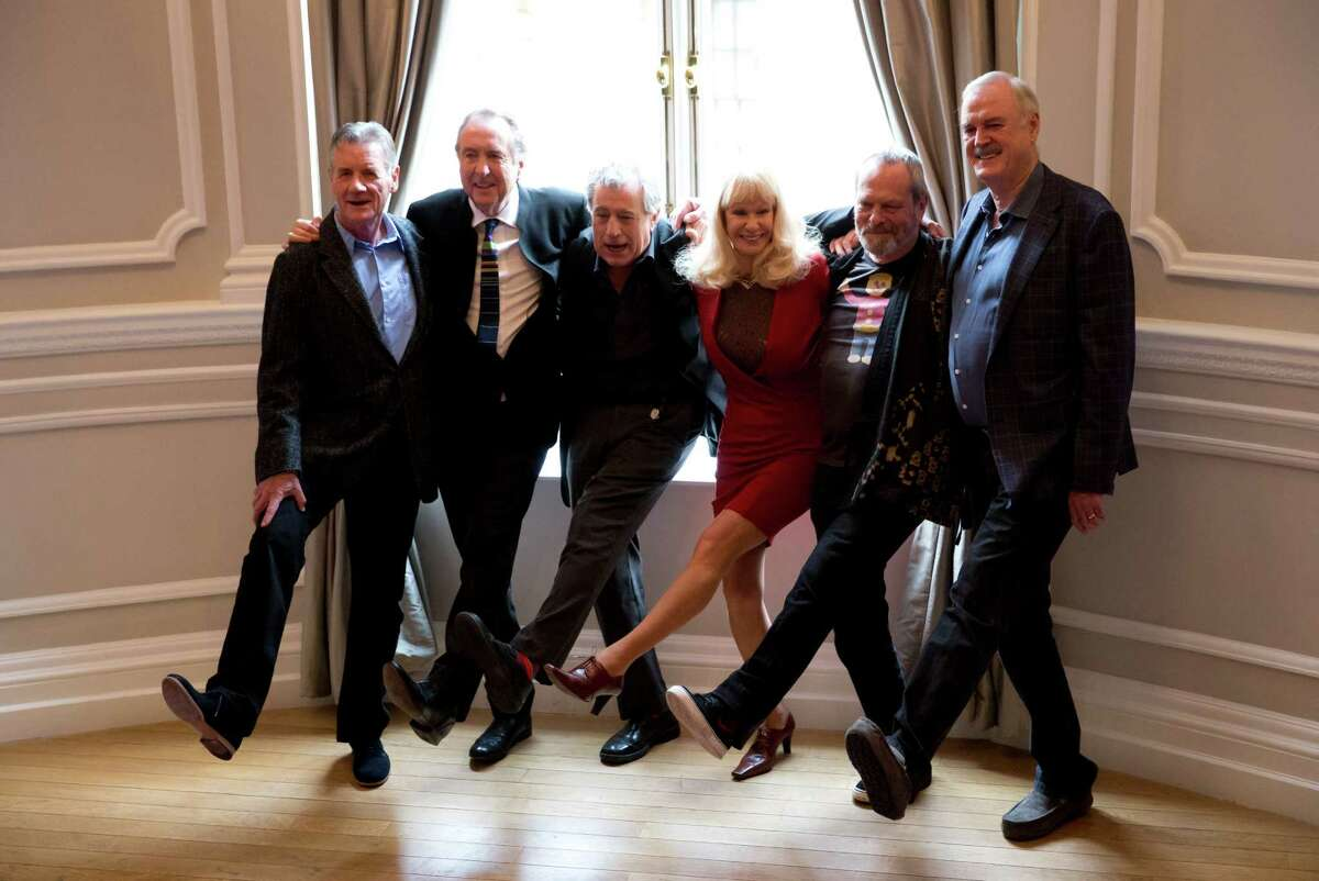 The surviving members of the Monty Python comedy group, from left, Michael Palin, Eric Idle, Terry Jones, Terry Gilliam, John Cleese and their co-star Carol Cleveland, fourth left, pose for photographers during a photocall to promote a reunion stage show they are going to perform together, at a hotel in London, Thursday, Nov. 21, 2013. The group had its first big success with the Monty Python's Flying Circus TV show, which ran from 1969 until 1974, winning fans around the world with its bizarre sketches. (AP Photo/Matt Dunham)