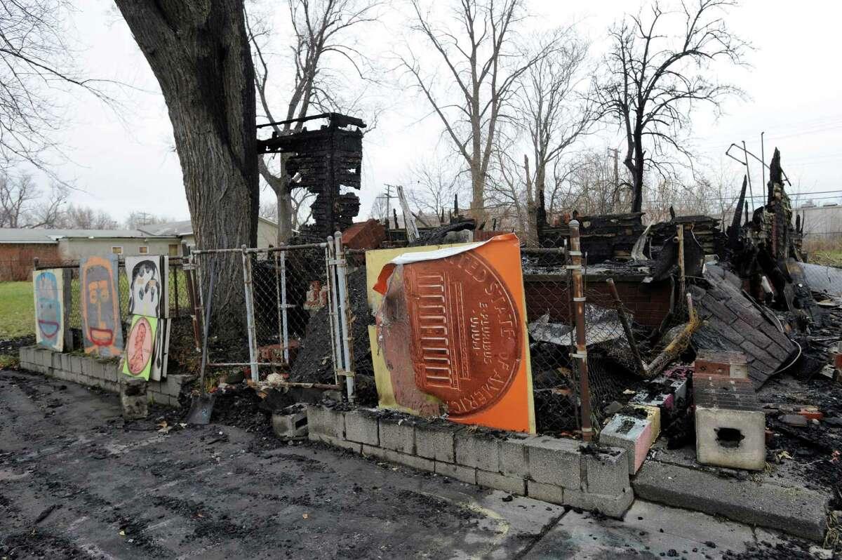 Artwork stands outside Detroit's Heidelberg Project outdoor art installation, after a fire Thursday.