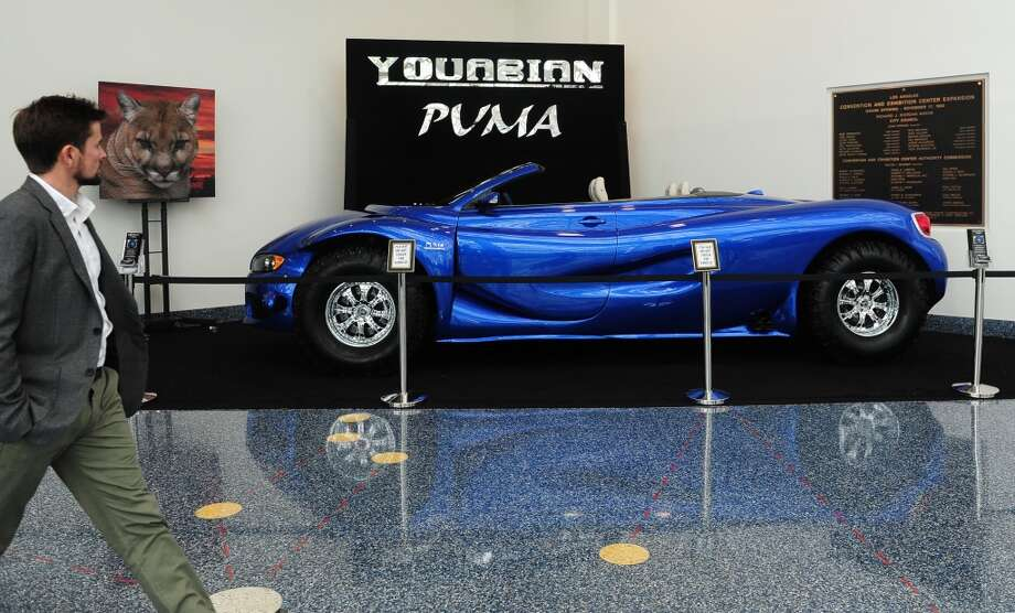 A man walks past the Youabian Puma, displayed on November 21, 2013 at the LA Auto Show in Los Angeles, California, which opens to the public from November 22 to December 1. AFP PHOTO/Frederic J. BROWN        (Photo credit should read FREDERIC J. BROWN/AFP/Getty Images) Photo: AFP/Getty Images