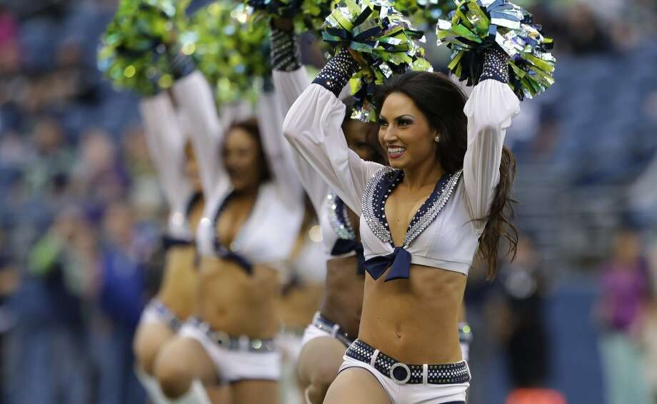 Members of the Sea Gals, the Seattle Seahawks cheerleaders, perform during the Raiders preseason game Aug. 29 at CenturyLink Field. Photo: Elaine Thompson, Associated Press