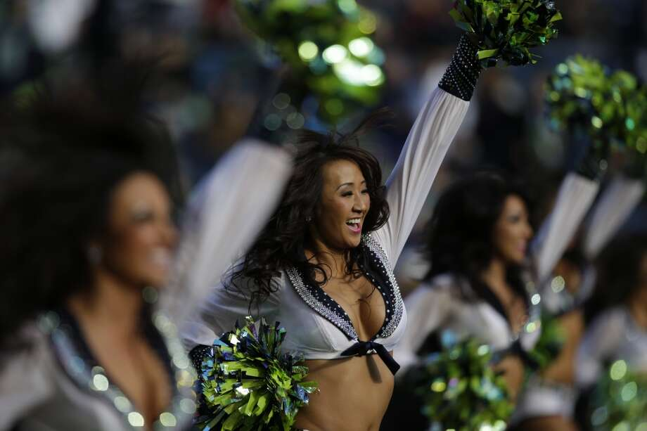 Seattle Seahawks Sea Gals cheerleaders perform Nov. 3, 2013. Photo: Elaine Thompson, Associated Press