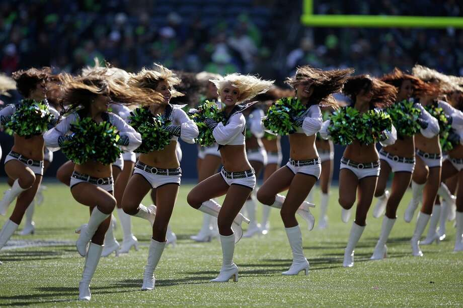 Seattle Seahawks Sea Gals cheerleaders perform Nov. 3, 2013. Photo: Elaine Thompson, Associated Press / AP2013