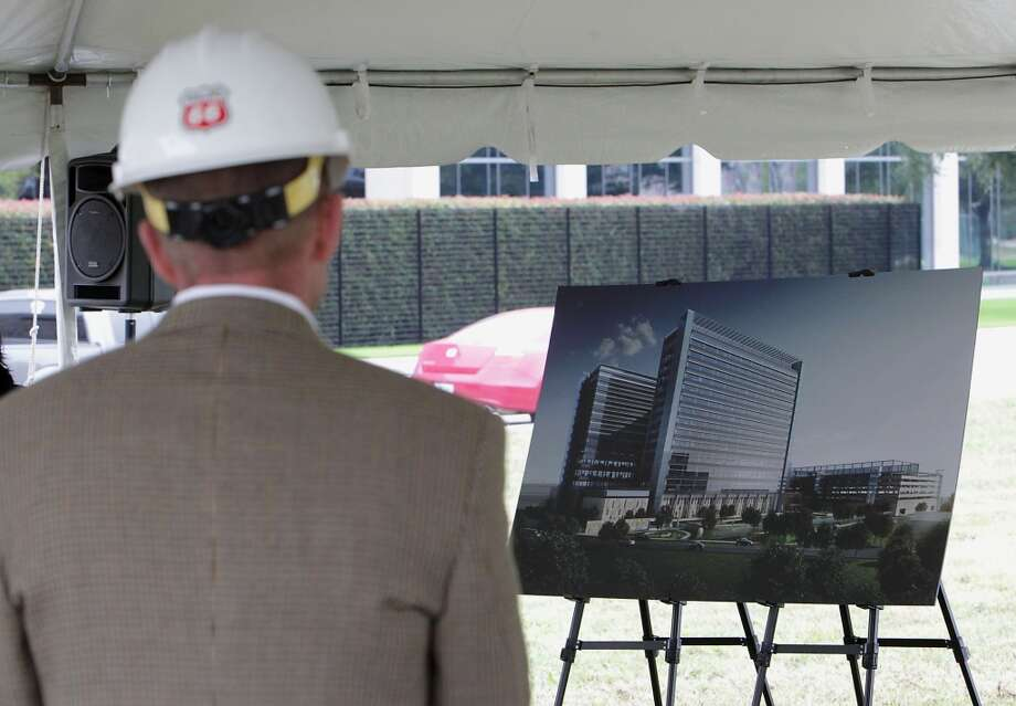 An artist rendering of the new Phillips 66 corporate headquarters campus in Westchase area during the ground breaking ceremony. The campus will feature twin 9 story buildings. Photo: James Nielsen, Houston Chronicle