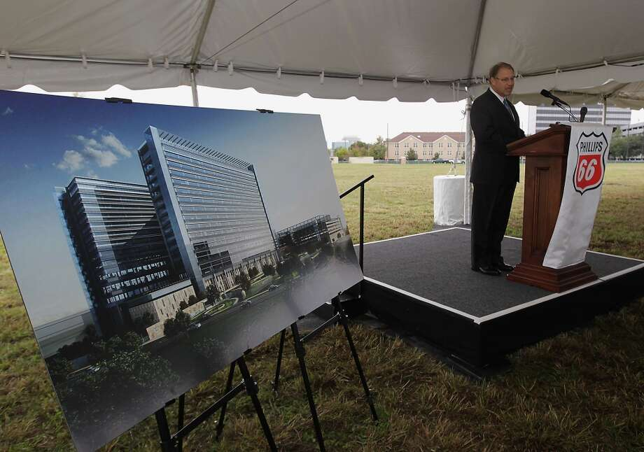 Phillips 66 Chairman and CEO Greg Garland speaks next to an artist rendering of the new Phillips 66 corporate headquarters campus in Westchase area during the groundbreaking ceremony. Photo: James Nielsen, Houston Chronicle