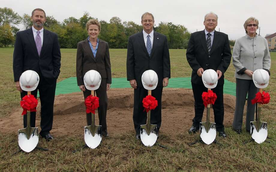 From left: Westchase District General Manager Jim Murphy; W.S. Bellows Construction Chairwoman and President Laura Bellows; Phillips 66 Chairman and CEO Greg Garland; HOK Senior Architect Dennis Laflen; and Phillips 66 Senior Vice President Human Resources Chantal Veevaete during the groundbreaking ceremony for the new Phillips 66 corporate headquarters campus in Westchase area. The campus will feature twin 9 story buildings. Photo: James Nielsen, Houston Chronicle