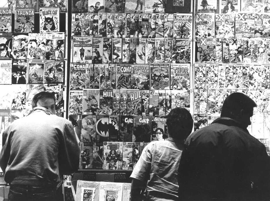 Comic book fans check a display at a convention held Nov. 27, 1988, at the Howard Johnson's in Stamford. Photo: File Photo, Advocate / Advocate