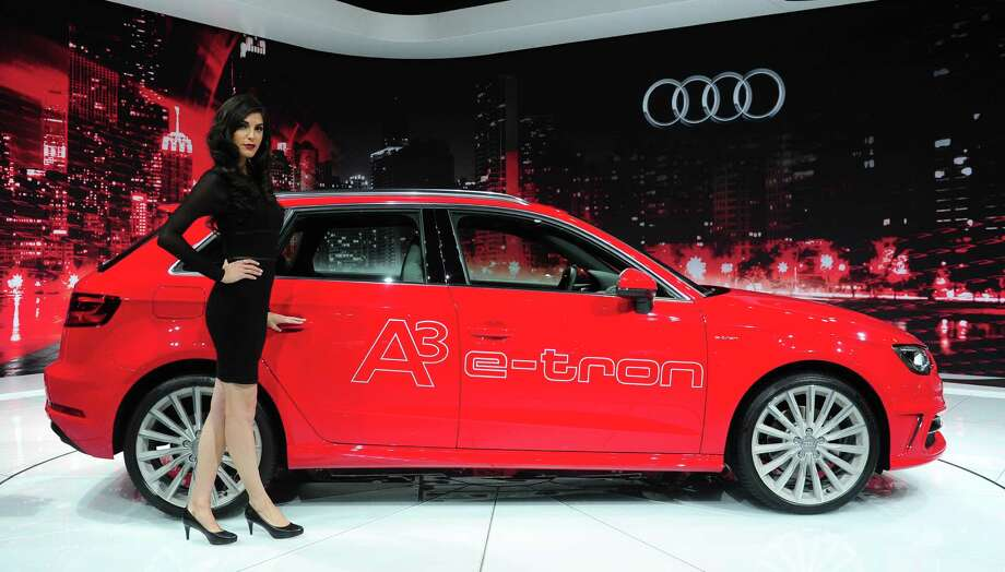 A spokesmodel poses beside the 2015 Audi A3 e-Tron displayed on November 21, 2013 at the LA Auto Show in Los Angeles, California. Photo: FREDERIC J. BROWN, Getty Images / 2013 AFP