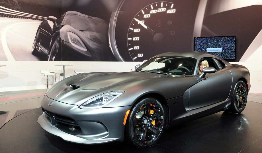 A spokesmodel poses in the driver's seat of a 2014 SRT Viper GTS from Dodge displayed on November 21, 2013 at the LA Auto Show in Los Angeles, California. Photo: FREDERIC J. BROWN, Getty Images / 2013 AFP