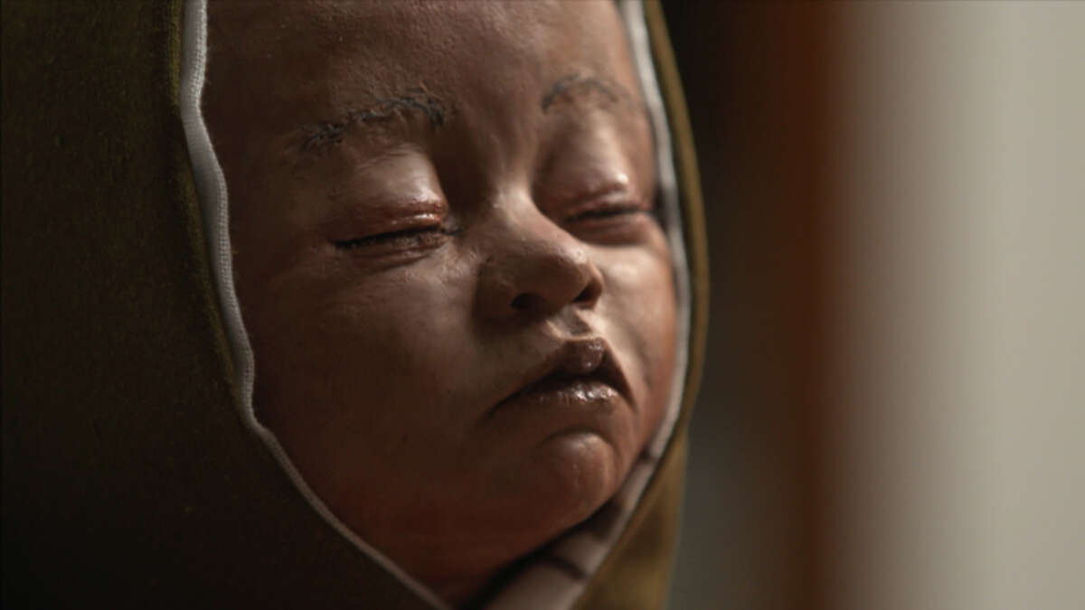 """This sculpture of a baby's face appears in the """"Sacrificial Child"""" episode of """"Lost Faces of the Bible."""""""
