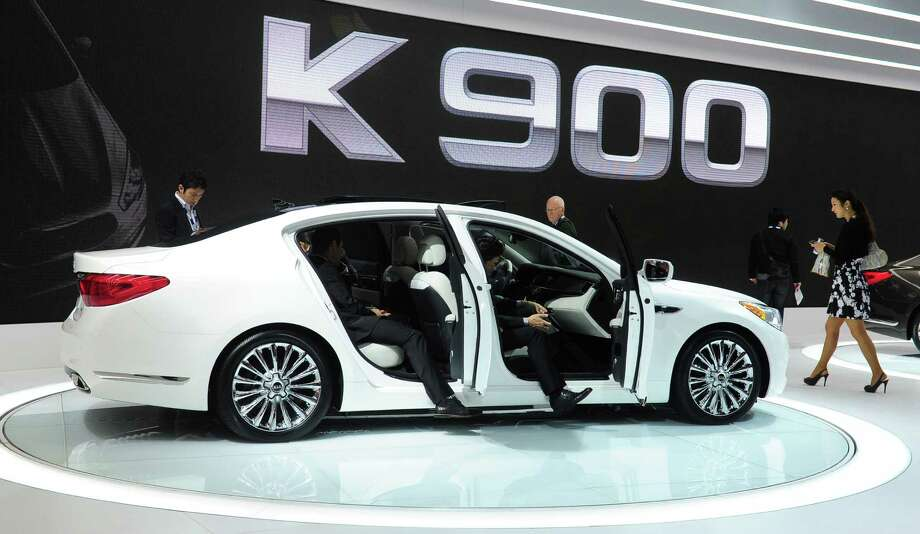 People test the interior of Kia's new K900 displayed on November 21, 2013 at the LA Auto Show in Los Angeles, California. Photo: FREDERIC J. BROWN, Getty Images / 2013 AFP