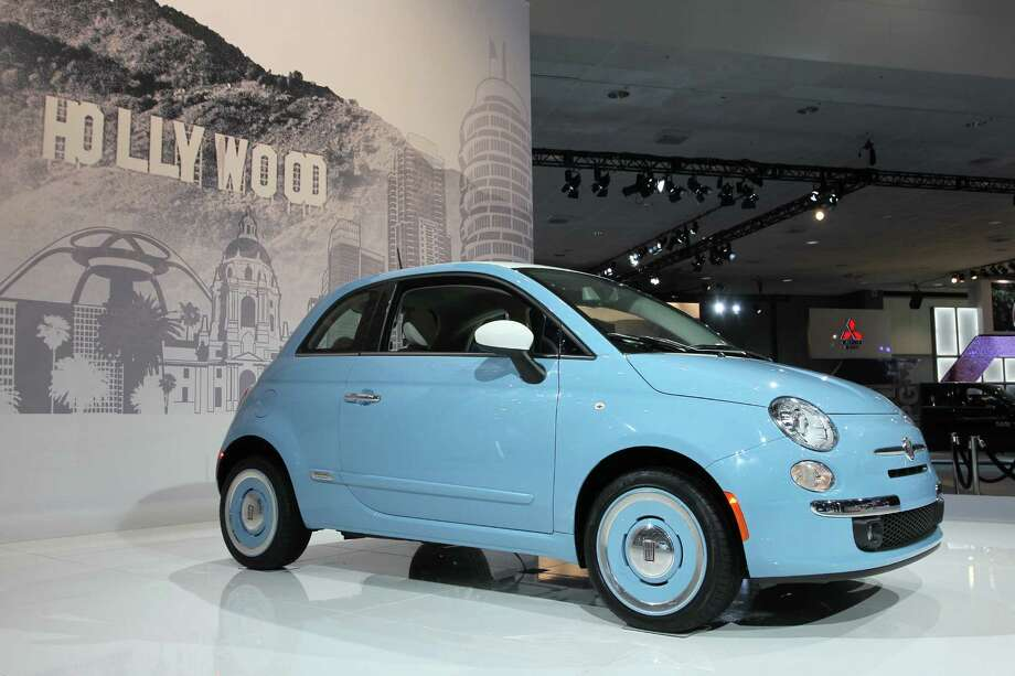 A Fiat 500 1957 Edition is displayed during media preview days at the 2013 Los Angeles Auto Show on November 20, 2013 in Los Angeles, California. Photo: David McNew, Getty Images / 2013 Getty Images