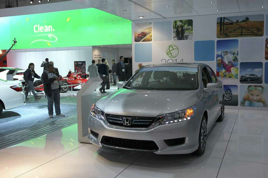 A Green Car of the Year award winning 2014 Honda Accord Hybrid is displayed at the 2013 Los Angeles Auto Show on November 21, 2013 in Los Angeles, California. Photo: David McNew, Getty Images / 2013 Getty Images