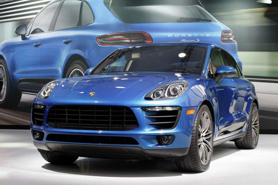A Porsche Macan S is shown during media preview days at the 2013 Los Angeles Auto Show on November 20, 2013 in Los Angeles, California. Photo: David McNew, Getty Images / 2013 Getty Images