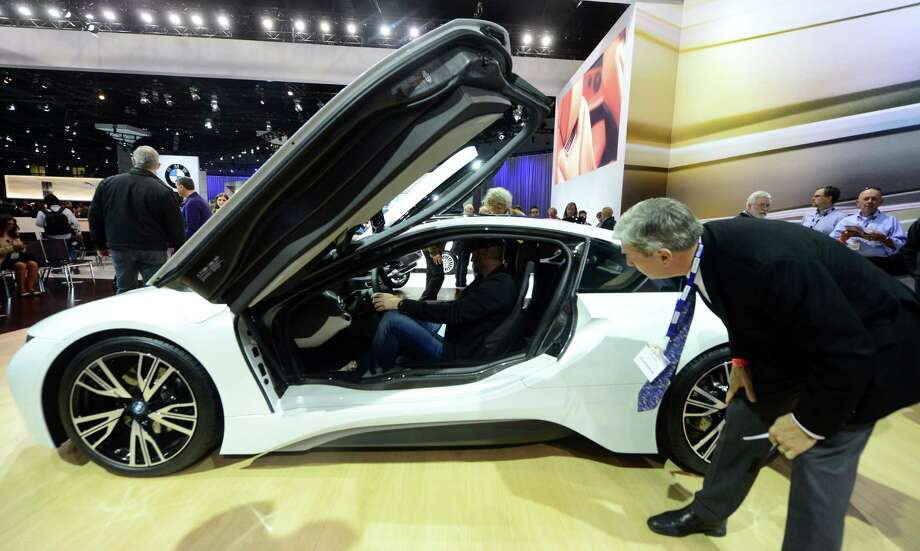 The BMW i8, due out next Summer, attracts attention while displayed on November 20, 2013 during media previews at the LA Auto Show in Los Angeles, California. Photo: FREDERIC J. BROWN, Getty Images / 2013 AFP