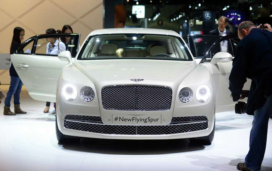The 2014 Bentley Flying Spur is displayed on November 20, 2013 during media previews at the LA Auto Show in Los Angeles, California. Photo: FREDERIC J. BROWN, Getty Images / 2013 AFP