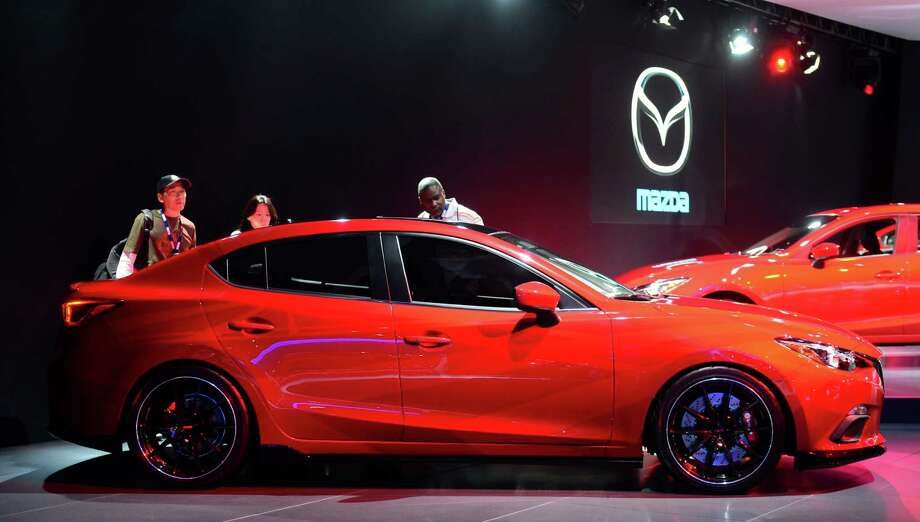 The 2014 Mazda3 is displayed on November 20, 2013 during media previews at the LA Auto Show in Los Angeles, California. Photo: FREDERIC J. BROWN, Getty Images / 2013 AFP