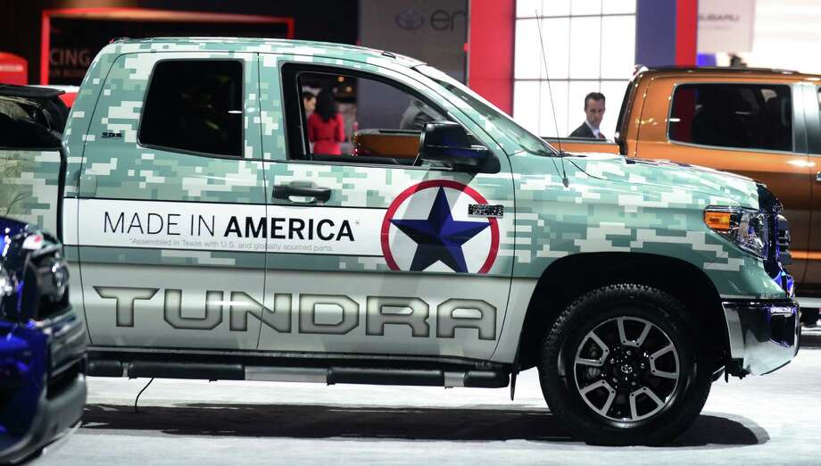 The Toyota Tundra iForce 5.7L V8 is displayed on November 20, 2013 during media previews at the LA Auto Show in Los Angeles, California. Photo: FREDERIC J. BROWN, Getty Images / 2013 AFP