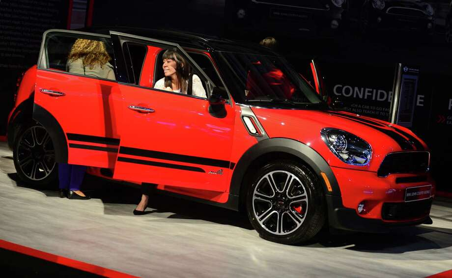 People test the interior of the new Mini John Cooper Works Countryman all4 displayed on November 20, 2013 during media previews at the LA Auto Show in Los Angeles, California. Photo: FREDERIC J. BROWN, Getty Images / 2013 AFP
