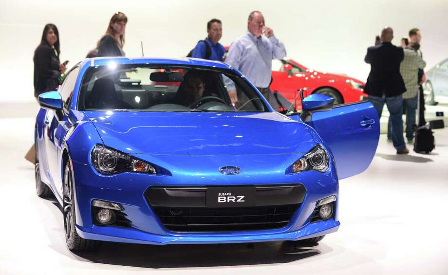 The 2014 Subaru BRZ is displayed on November 20, 2013 during media previews at the LA Auto Show in Los Angeles, California. Photo: FREDERIC J. BROWN, Getty Images / 2013 AFP