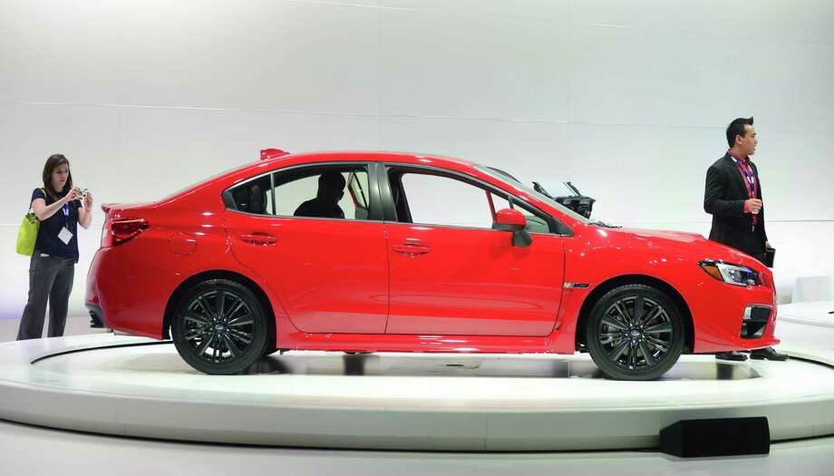 The Subaru WRX is displayed on November 20, 2013 during media previews at the LA Auto Show in Los Angeles, California. Photo: FREDERIC J. BROWN, Getty Images / 2013 AFP