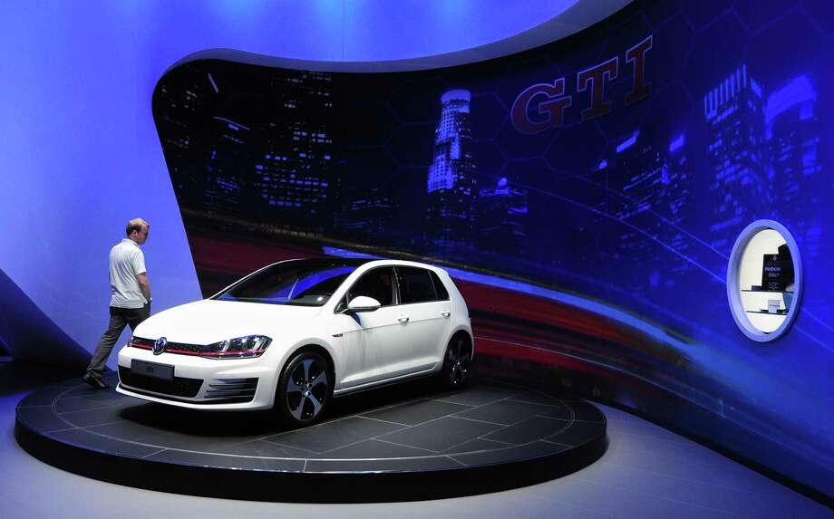 The 2015 VW Golf GTI, due out next Spring, is displayed on November 20, 2013 during media previews at the LA Auto Show in Los Angeles, California. Photo: FREDERIC J. BROWN, Getty Images / 2013 AFP