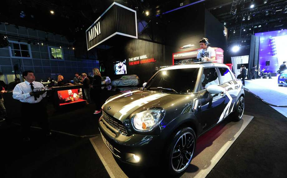 A disc jockey works out of the back of a Mini Countryman Cooper displayed on November 20, 2013 during media previews at the LA Auto Show in Los Angeles, California. Photo: FREDERIC J. BROWN, Getty Images / 2013 AFP