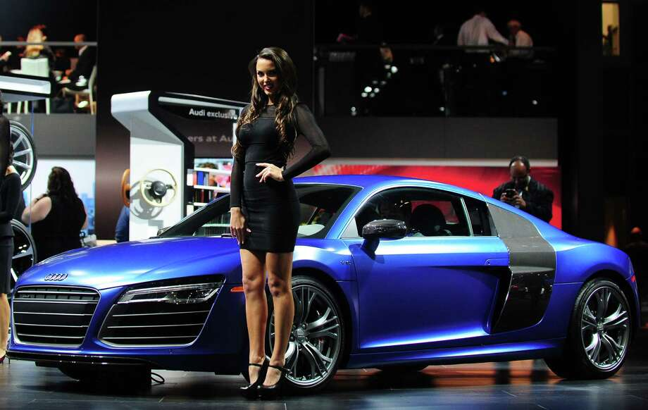 A spokesmodel poses beside the Audi R8 displayed on November 20, 2013 during media previews at the LA Auto Show in Los Angeles, California. Photo: FREDERIC J. BROWN, Getty Images / 2013 AFP
