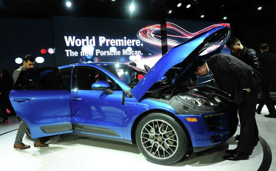 The 2014 Porsche Macan SUV attracts attention after it was unveiled to the media on November 20, 2013 at the LA Auto Show in Los Angeles, California. Photo: FREDERIC J. BROWN, Getty Images / 2013 AFP