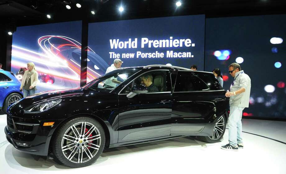 The 2014 Porsche Macan SUV attracts attention after it was unveiled to the media on November 20, 2013 at the LA Auto Show in Los Angeles. Photo: FREDERIC J. BROWN, Getty Images / 2013 AFP
