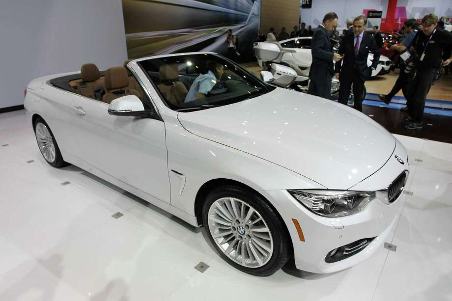 A 2014 BMW 428i convertible is shown during media preview days at the 2013 Los Angeles Auto Show on November 20, 2013 in Los Angeles, California. Photo: David McNew, Getty Images / 2013 Getty Images