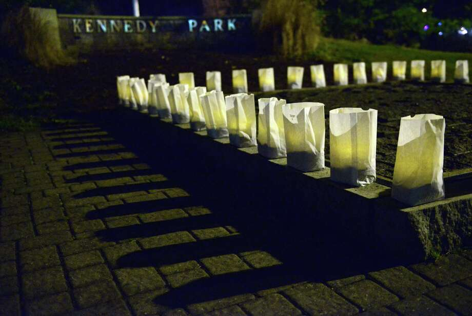 Luminaries line the fountain at Kennedy Park in Danbury during the John F. Kennedy remembrance ceremony, presented by CityCenter Danbury and the Danbury Democratic Town Committee, on Friday, Nov. 22, 2013.  The ceremony, on the 50th anniversary of his assassination, included the lighting of luminaries surrounding the park's fountain, the laying of a wreath by Mayor Mark Boughton and former Mayor Gene Eriquez, and speeches of remembrance from area officials. Photo: Tyler Sizemore / The News-Times