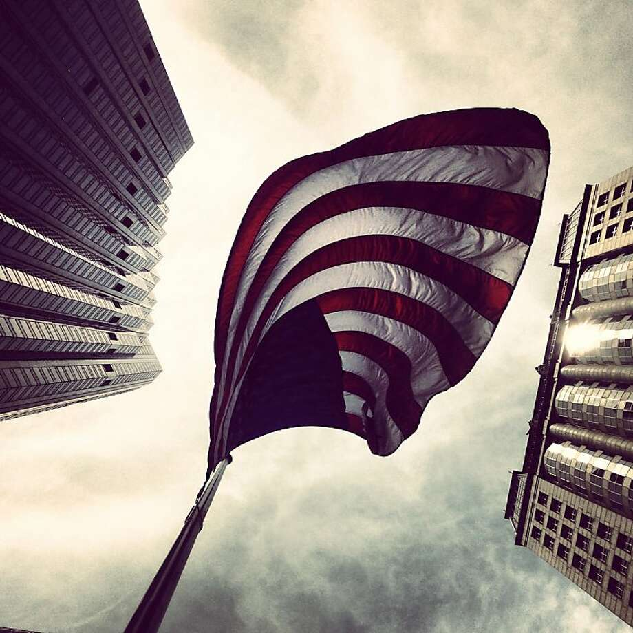 The picture was taken on my lunch break while working at a non-profit called Net Impact around the month of July 2013. I must have taken 15 shots on my iPhone 5 to get the one I liked. This American flag is located on California and Kearny. I love taking shots of the City. It's a photogenic city so it makes my hobby a rewarding one. @ajmay_sf Photo: Anthony Jay May
