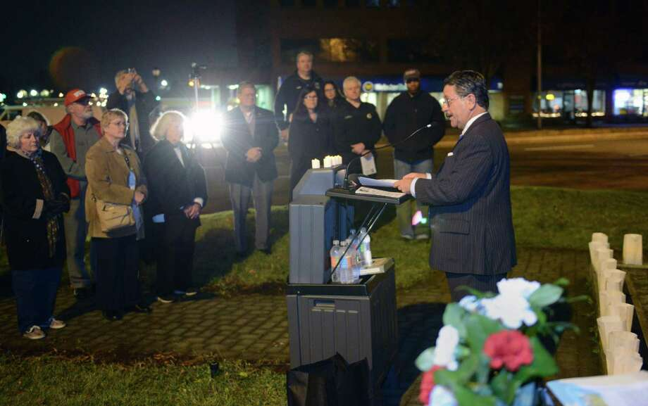 Former Danbury Mayor Gene Eriquez speaks at the John F. Kennedy remembrance ceremony, presented by CityCenter Danbury and the Danbury Democratic Town Committee, at Kennedy Park in Danbury, Conn. on Friday, Nov. 22, 2013.  The ceremony, on the 50th anniversary of his assassination, included the lighting of luminaries surrounding the park's fountain, the laying of a wreath by Mayor Mark Boughton and former Mayor Gene Eriquez, and speeches of remembrance from area officials. Photo: Tyler Sizemore / The News-Times