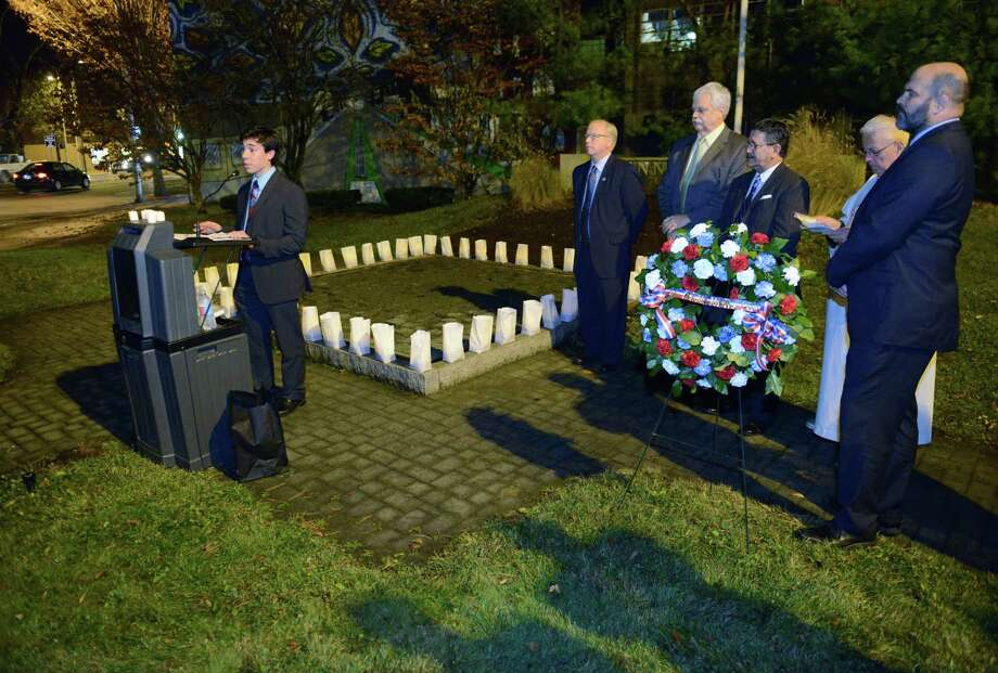 State Rep. David Arconti, left, speaks at the John F. Kennedy remembrance ceremony, presented by CityCenter Danbury and the Danbury Democratic Town Committee, at Kennedy Park in Danbury, Conn. on Friday, Nov. 22, 2013.  The ceremony, on the 50th anniversary of his assassination, included the lighting of luminaries surrounding the park's fountain, the laying of a wreath by Mayor Mark Boughton and former Mayor Gene Eriquez, and speeches of remembrance from area officials. Photo: Tyler Sizemore / The News-Times