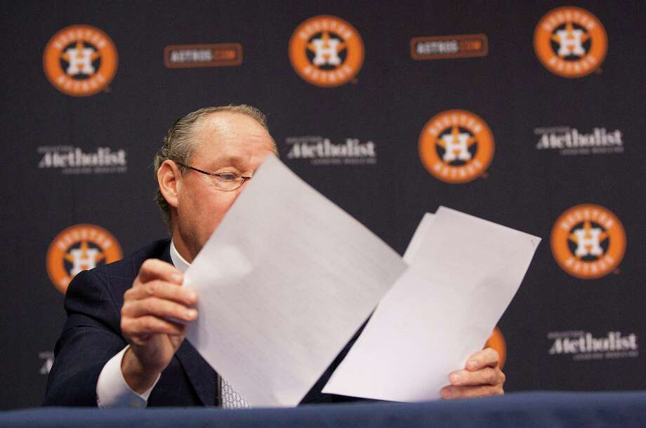 Astros owner Jim Crane reads from a prepared statement Friday during a news conference concerning his lawsuit. Photo: Johnny Hanson, Staff / Houston Chronicle