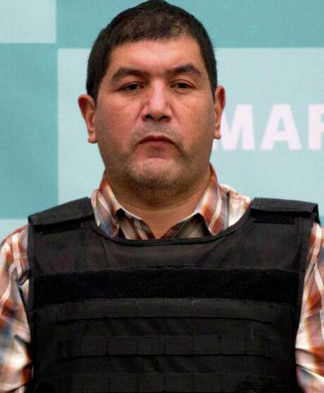 """The alleged leader of a faction of the hyper-violent Zetas cartel, Ivan Velazquez Caballero, known as """"El Taliban,""""  is shown during a media presentation at the Mexican Navy's Center for Advanced Naval Studies in Mexico City,Thursday, Sept. 27, 2012. Velazquez Caballero allegedly has been fighting a bloody internal battle with top Zetas' leader Miguel Angel Trevino Morales, and officials have said the split was behind a recent surge in massacres and shootouts, particularly in northern Mexico. (AP Photo/Eduardo Verdugo) Photo: Eduardo Verdugo, STF / AP"""