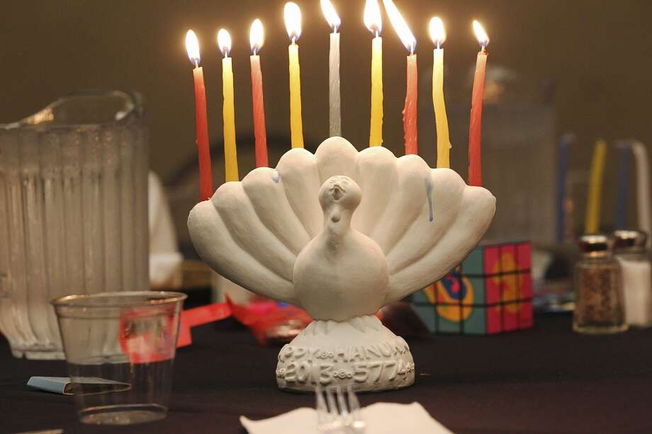 """1. Use a menorah as your centerpiece. There's never been more of an incentive to time your Thanksgiving feast with sundown.  You might even want to find a """"menurkey,"""" a menorah shaped like a turkey. Photo: Jerry Lara, San Antonio Express-News"""