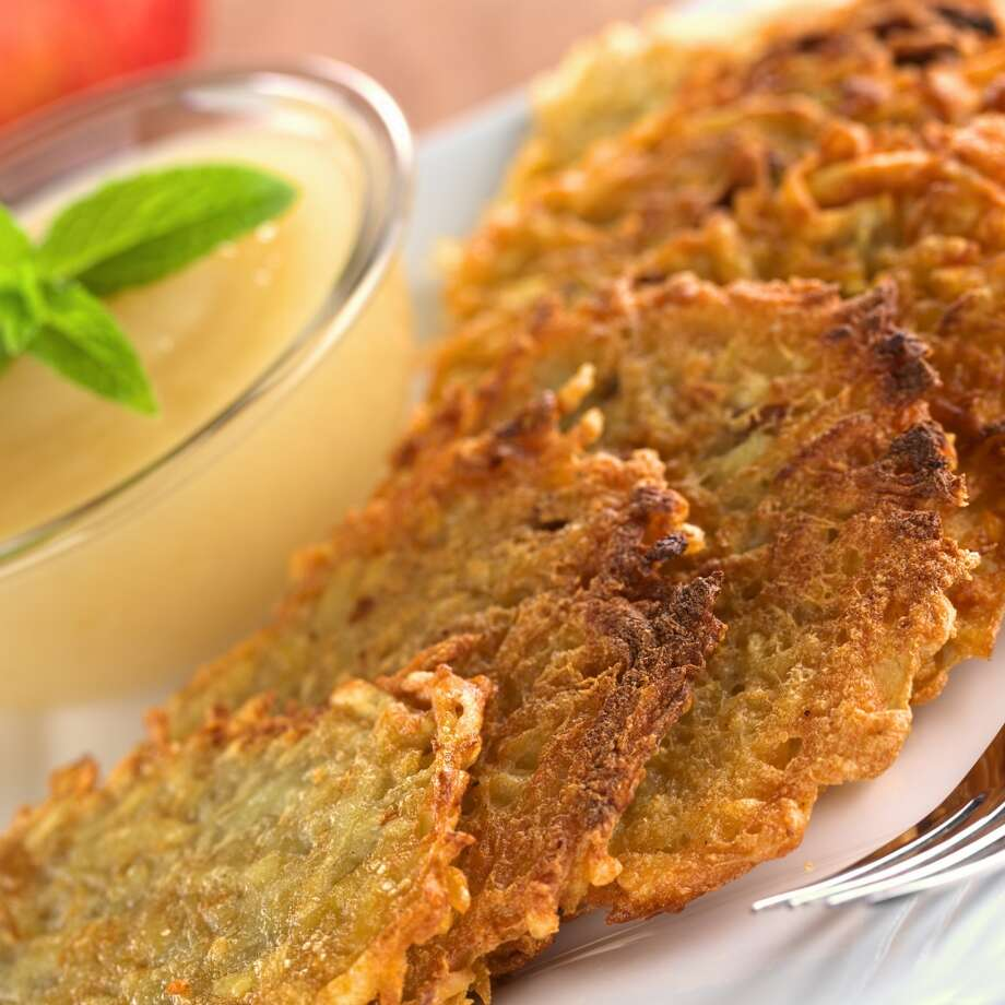 3. Make sweet potato latkes. Mashed potatoes and sweet potatoes are a staple in every Thanksgiving meal. Why not try a variation this year and turn your potatoes into latkes, the most popular Hanukkah food? Photo: Courtesy Photo, BigOven.com